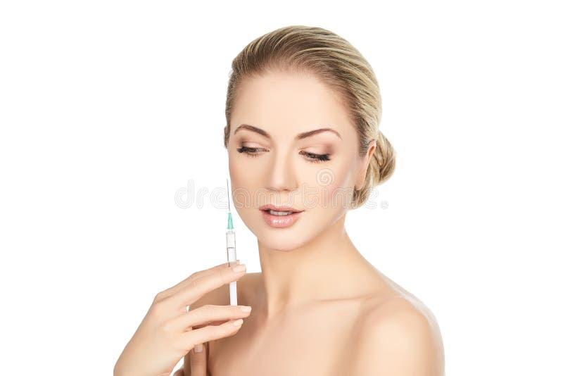 Beautiful girl holding syringe isolated on white royalty free stock photo