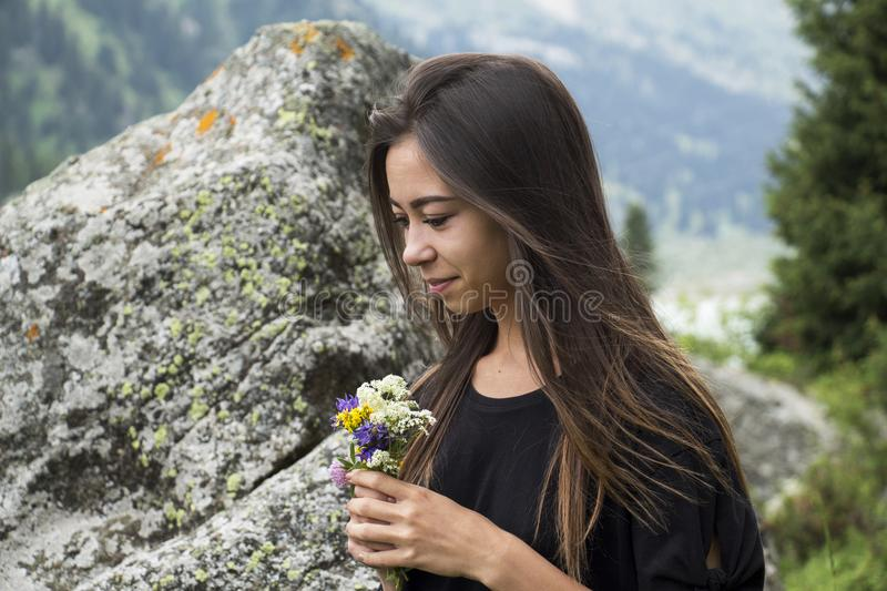 Portrait of beautiful girl with flowers royalty free stock photo