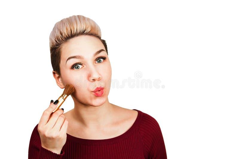 Beautiful girl holds brush for make up. Isolated on white background royalty free stock photo