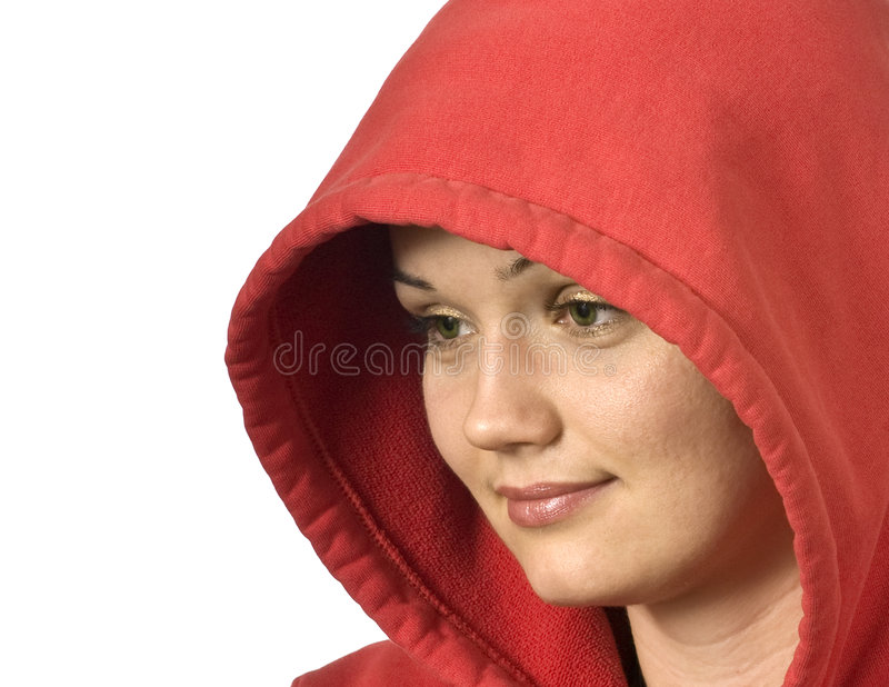 Beautiful girl in a hood looking at blank space stock image