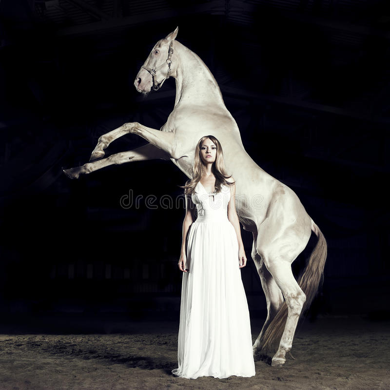 Beautiful girl and horse stock photos