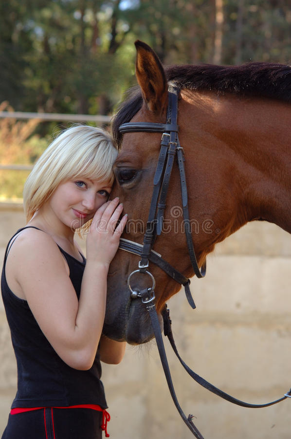 Download Beautiful girl and horse stock photo. Image of stallion - 9551630