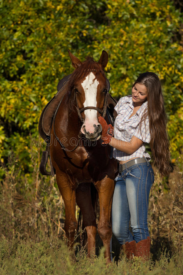 Beautiful girl with a horse stock photography