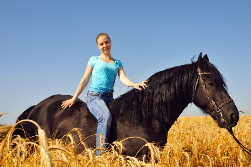 Beautiful girl on horseback royalty free stock photos