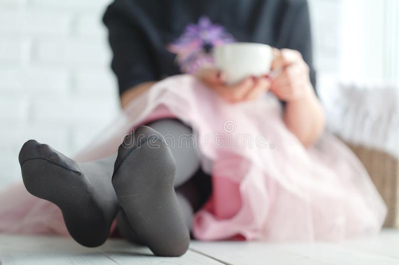 Beautiful girl with hot drink relaxing at home royalty free stock photography