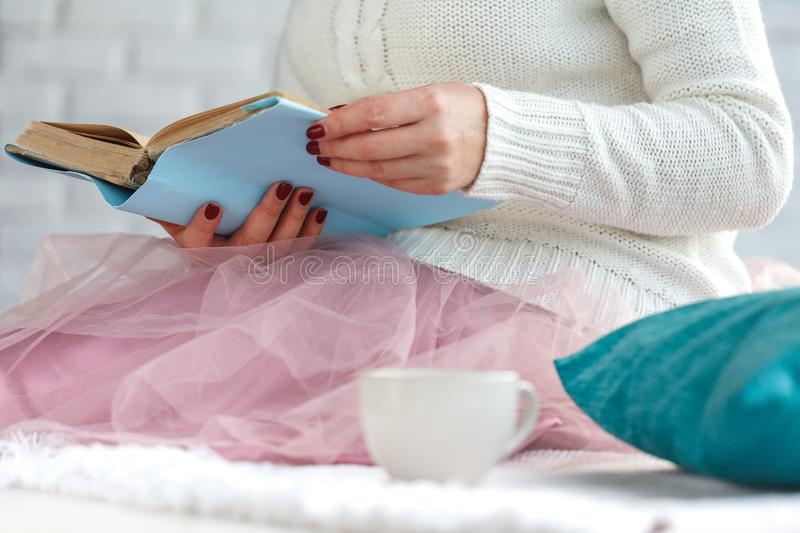 Beautiful girl with hot drink relaxing at home royalty free stock image
