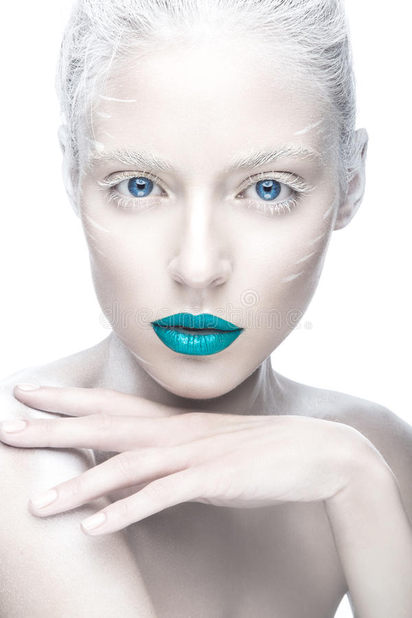 Beautiful girl in the image of albino with blue lips and white eyes. Art beauty face. royalty free stock photography