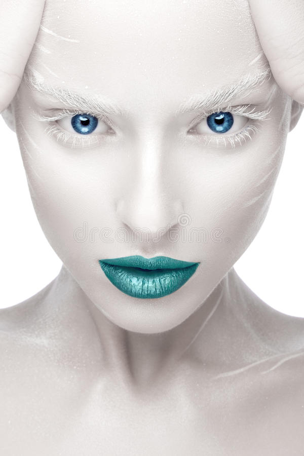 Beautiful girl in the image of albino with blue lips and white eyes. Art beauty face. Picture taken in the studio on a white background royalty free stock images