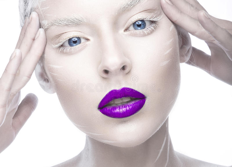 Beautiful girl in the image of albino with purple lips and white eyes. Art beauty face. stock photography
