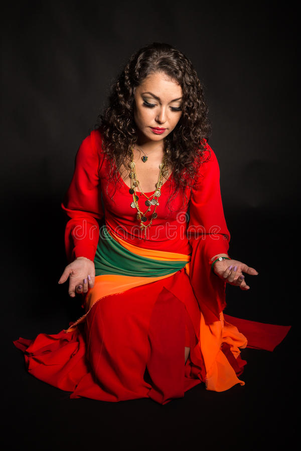 Beautiful girl in the image of a gypsy on a dark background royalty free stock image