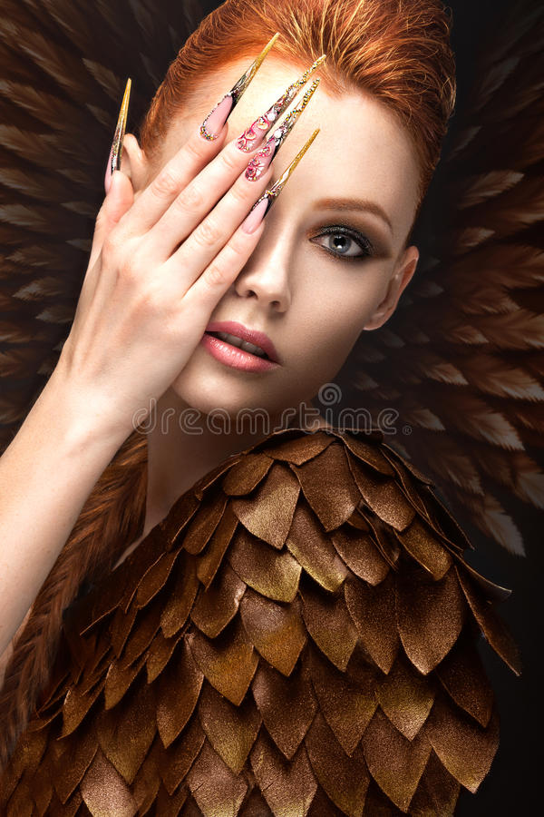 Beautiful Girl In The Image Of The Phoenix With Bright Makeup ...