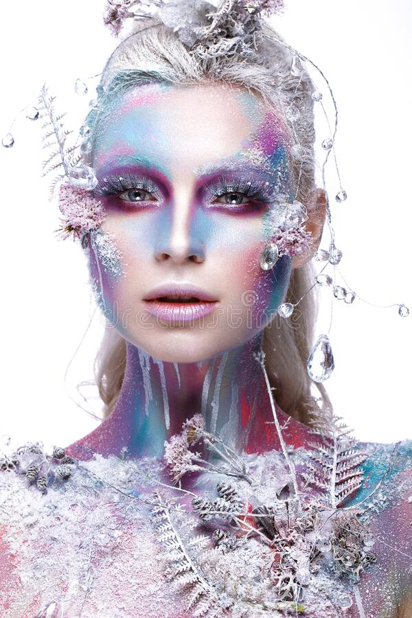 Beautiful girl in the image of a snowy unicorn creature. Creative make up. Art look. Beautiful girl in the image of a snowy unicorn creature. Creative make up stock photography