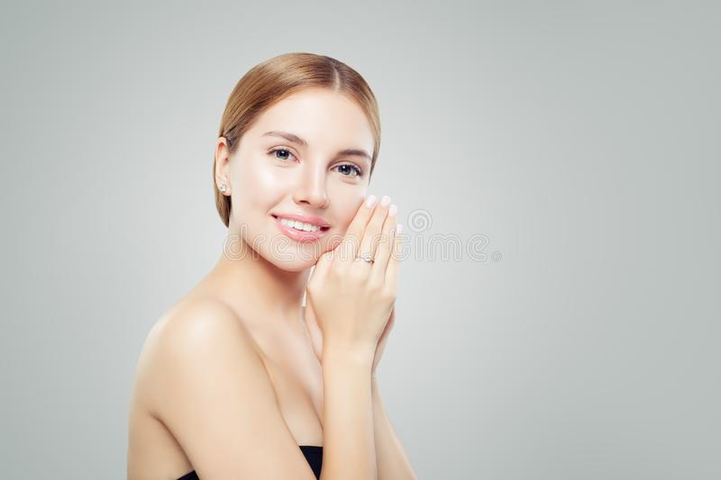 Beautiful girl with jewelry. Young woman in earrings and ring. Beauty and accessories royalty free stock photography