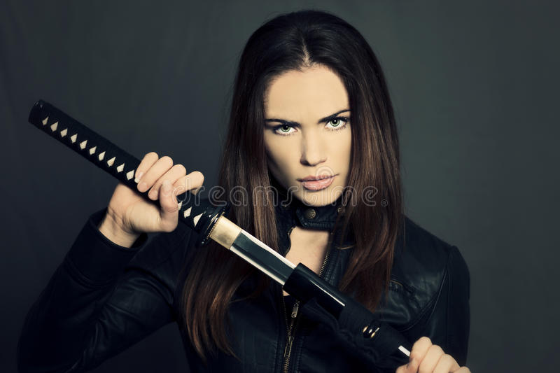 Katana girl. Beautiful girl with Katana in studio royalty free stock photography
