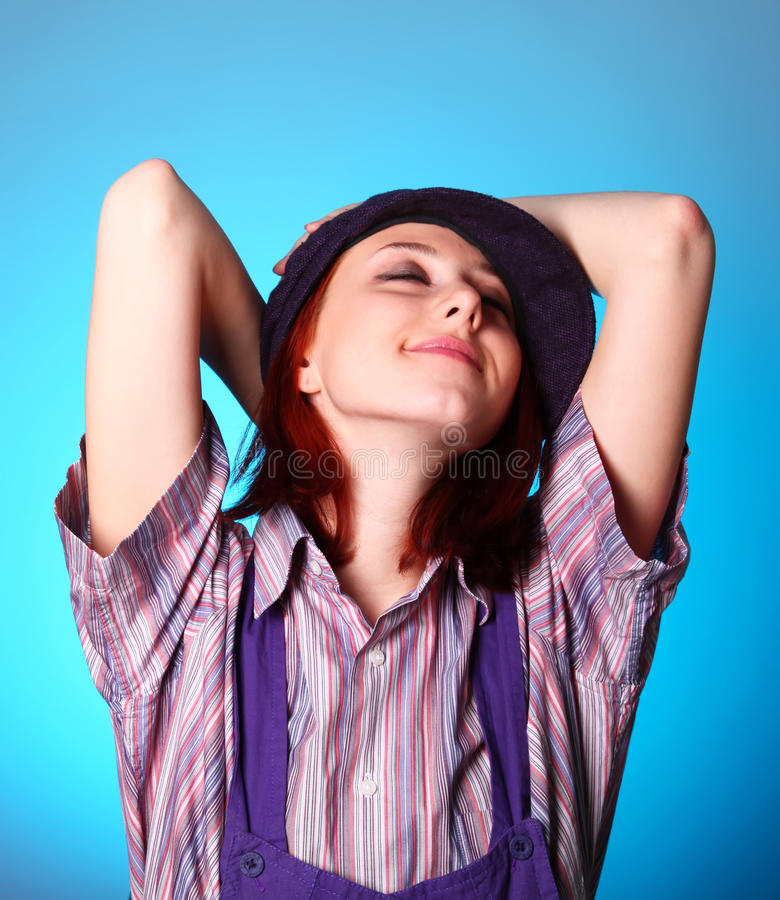 Free Beautiful Girl Keep Hands Near Cap And Smiling Stock Photos - 12611763