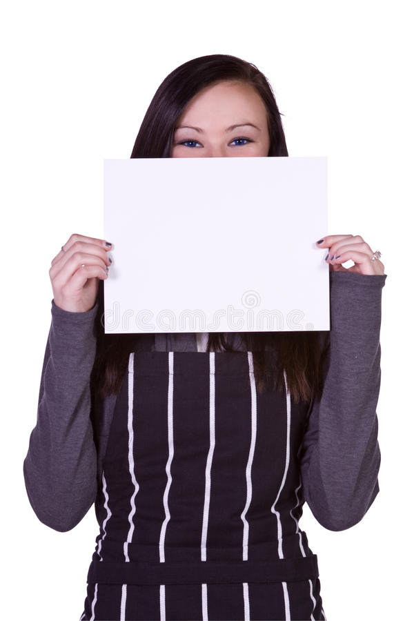 Beautiful Girl in the Kitchen Holding a Blank Sign stock image