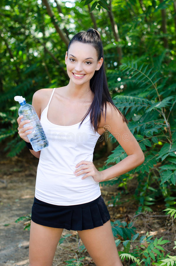 Free Beautiful Girl Laughing Holding A Bottle Of Water Royalty Free Stock Images - 27620849