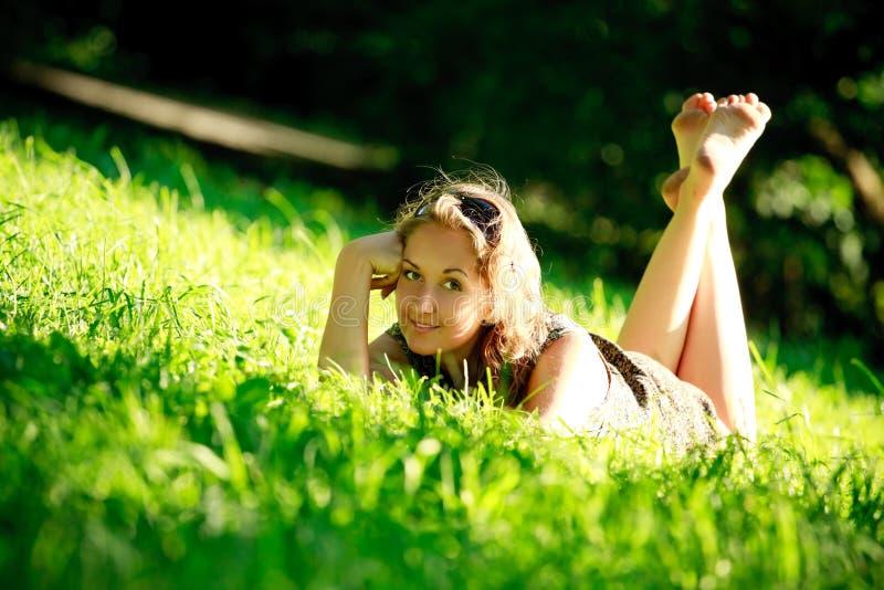 Beautiful girl laying on sunny meadow