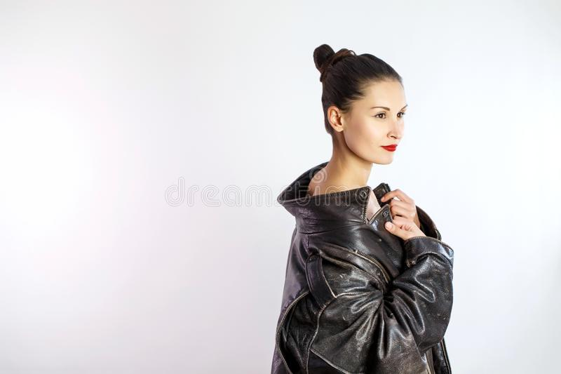 Beautiful girl in leather men jacket smiling on white isolated background. Half-naked portrait royalty free stock images