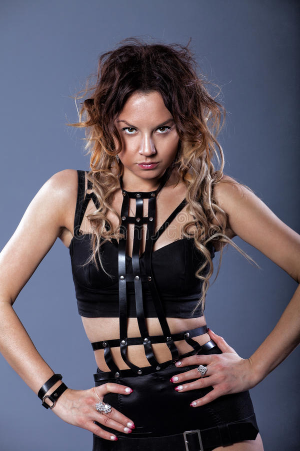 Beautiful girl in a leather sword belt stock photos