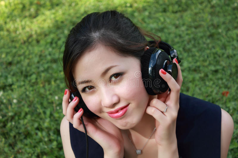 Download Beautiful Girl Listening Music In The Park Royalty Free Stock Photography - Image: 16163287