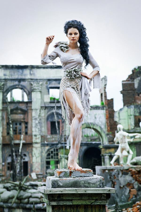 Beautiful girl in the ruins of the city. stock photo
