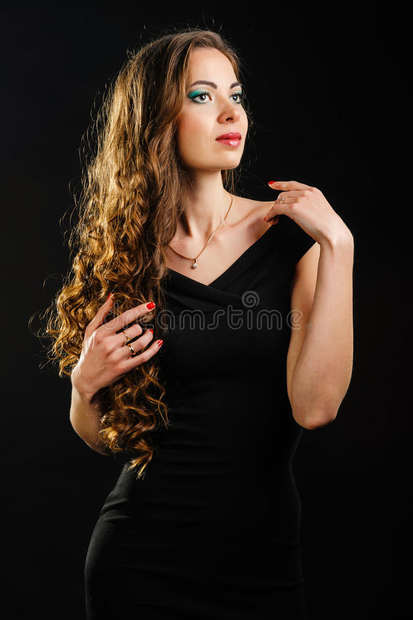 Beautiful girl with long curls royalty free stock photography