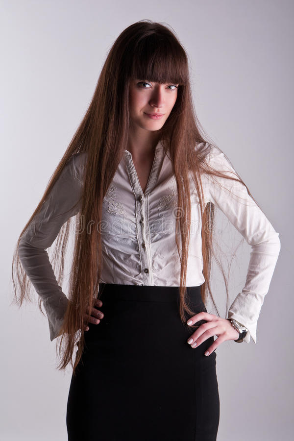 A beautiful girl with long hair royalty free stock photos