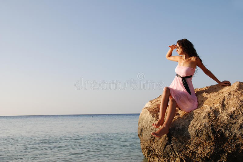 Beautiful girl looking far away stock images