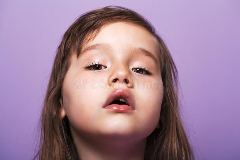 Beautiful girl loosing baby teeth. Beautiful girl portrait losing her baby teeth royalty free stock photo