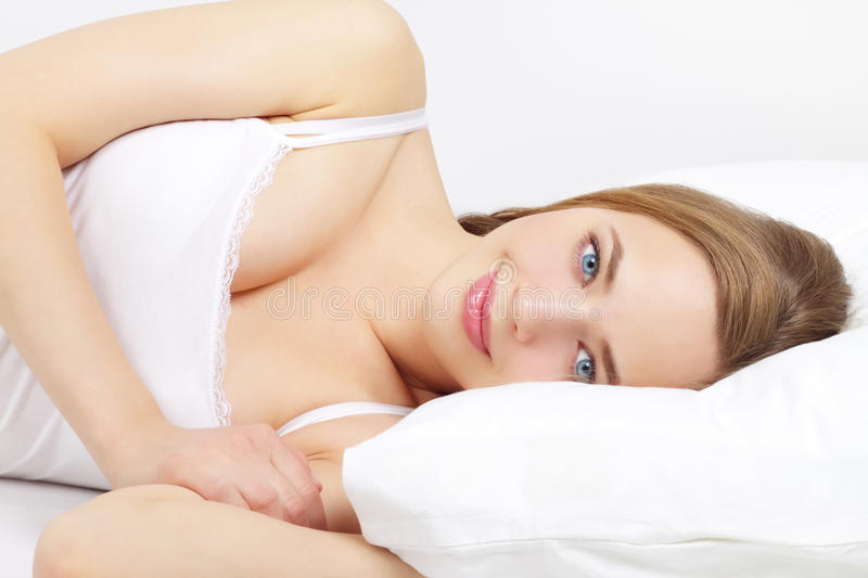 Download Beautiful Girl Lying On A Bed Stock Photo - Image: 23568708