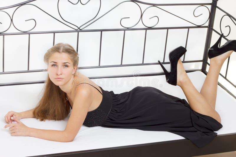 Beautiful girl lying on the bed stock photo