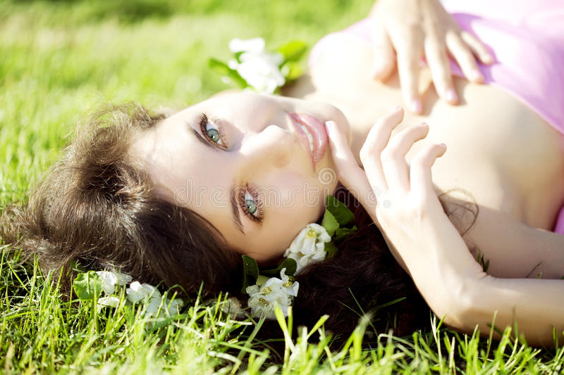 Download Beautiful Girl Lying On The Grass With Flowers Stock Photo - Image: 14800772