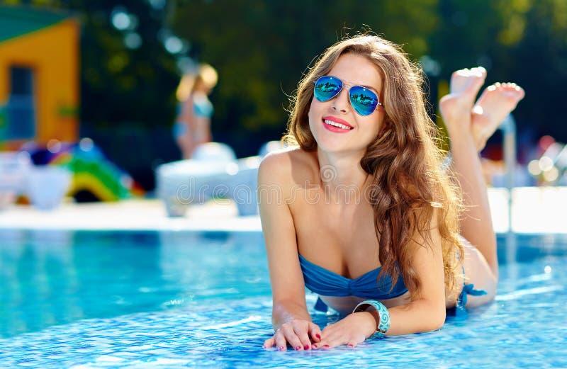 Beautiful girl lying near swimming pool stock photo - Where is my nearest swimming pool ...