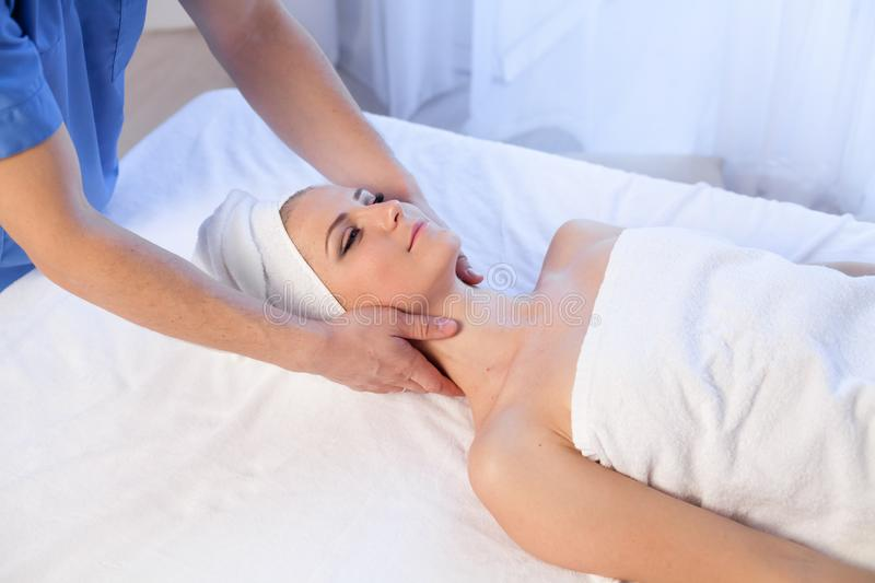 Beautiful girl make massage therapy neck in Spa. 1 royalty free stock photography