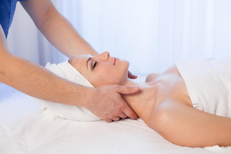 Beautiful girl make massage therapy neck in Spa. 1 royalty free stock images