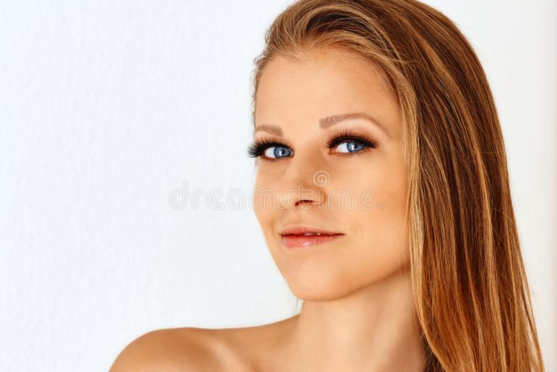 Beautiful girl with make up and perfect skin. Eyelash extensions, cosmetology, beauty and skin care stock photography