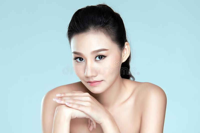Beauty woman asia isolated on blue background. stock photos