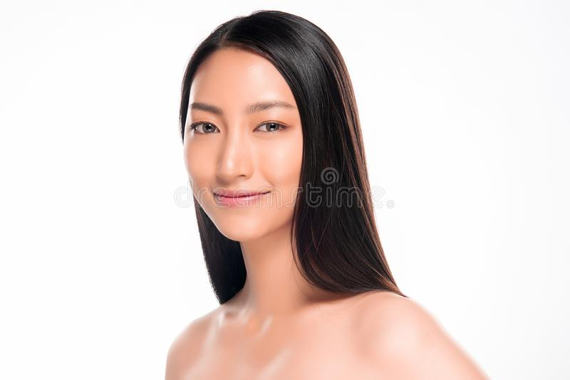 Beautiful smiling asian woman with natural make-up, clean skin royalty free stock photo