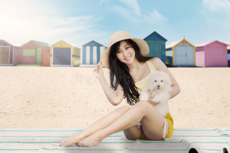 Beautiful girl with maltese dog royalty free stock images