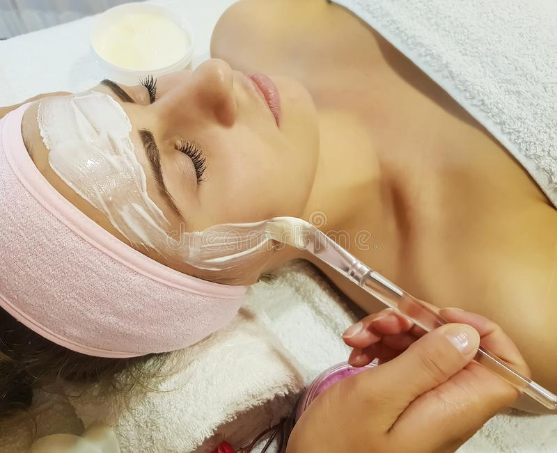 Beautiful girl, mask cosmetic beautician healthy in spa salon moisturizer skincare cosmetology , relaxation young royalty free stock image