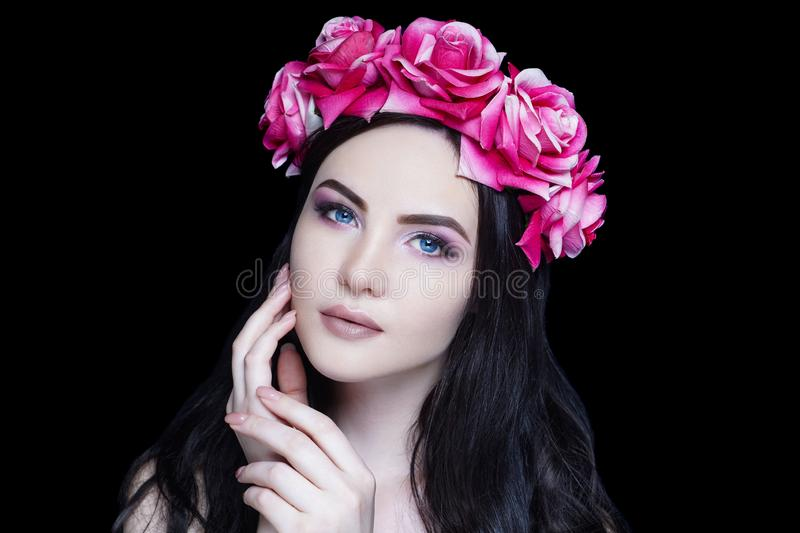 Beautiful girl, massive accessory flowers crown stock photo