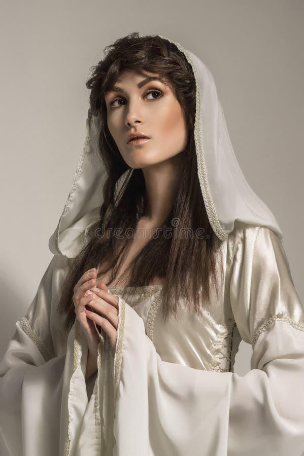 Beautiful Girl in medieval beautiful dress. In studio royalty free stock image