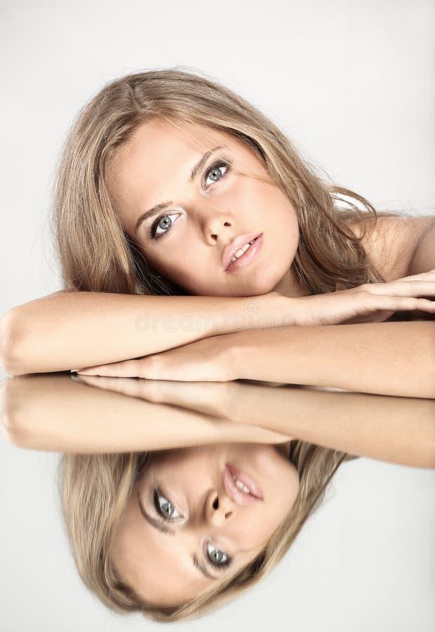 Beautiful girl with a mirror stock photos