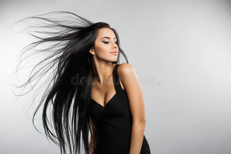 Beautiful girl model with flying the wind hair. stock image
