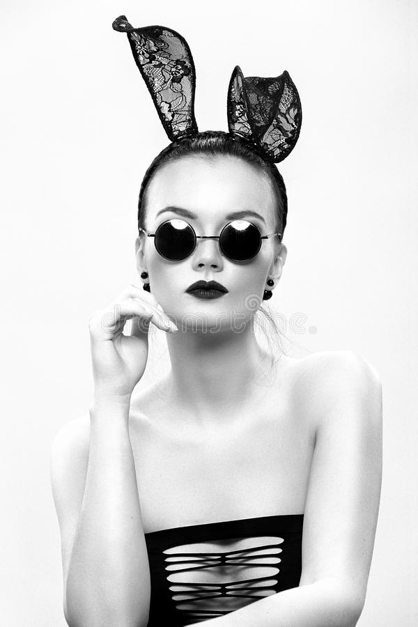 The beautiful girl model in an image of a rabbit royalty free stock photo