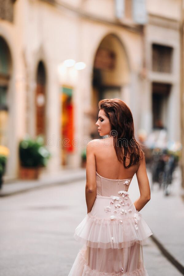 Beautiful girl model in pink wedding dress photographed in Florence, photo shoot in Florence bride.  stock photography
