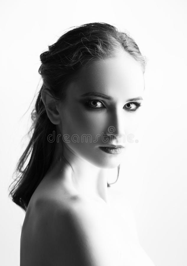 Beautiful girl model with red lips make up and naked shoulders. Classic close up beauty. black and white portrait. Isolated on stock photos