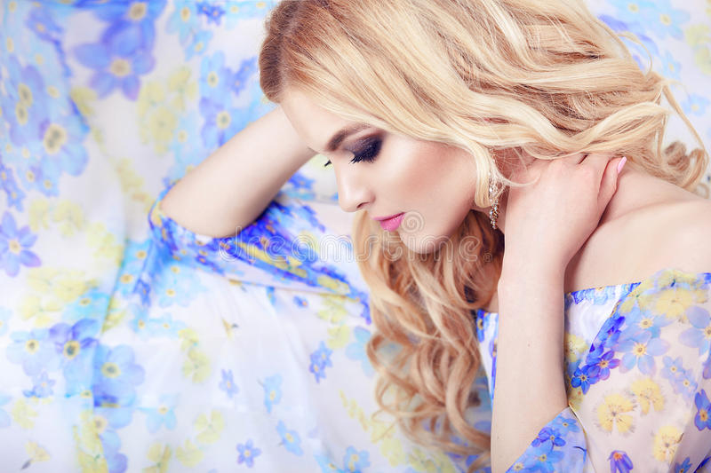 Beautiful girl model woman portrait professional makiyad and hair in a flower dress on a floral background , bright tone , pink li. Ps , blonde hair , blonde stock images
