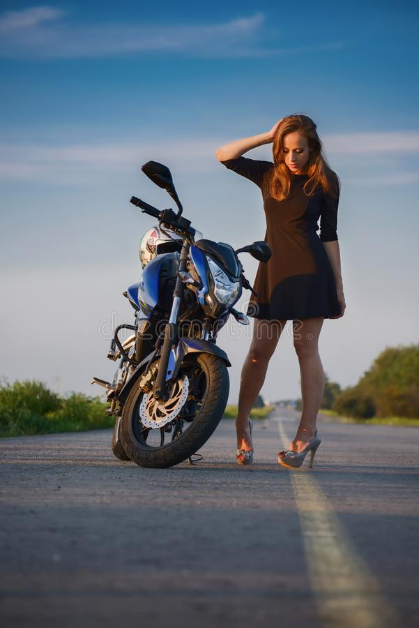 Beautiful girl and motorcycle stock photo